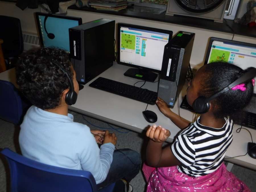 A boy and girl using a computer
